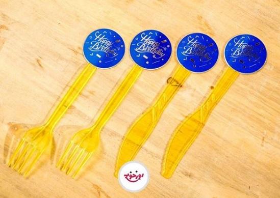 چنگال و چاقو طلایی با لیبل آبی طلا کوب